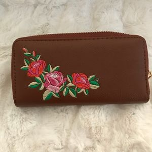 Very good leather wallet with flower stitching